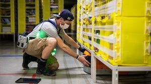 Amazon associate wearing PPE | Source: Amazon