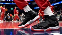 Air Jordan shoes on a basketball court in December | Source: Will Newton/Getty Images