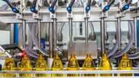 Machine fills up empty bottles at L'Oréal production facility | Source: Getty Images