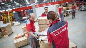 JD.com warehouse staff | Source: Shutterstock