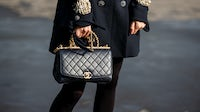 Woman holds Chanel bag | Getty Images