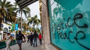 A graffitied store window on luxury mecca Rodeo Drive after demonstrators protested the death of George Floyd | Photo: Getty