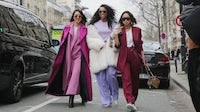 Instagram's Eva Chen with Shiona Turini and Aimee Song at Paris Fashion Week | Source: Getty Images