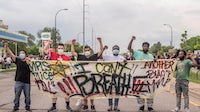 Protesters in Minneapolis march after the death of George Floyd | Source: Shutterstock