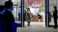 A customer walks out of Mitsukoshi department store after being closed earlier than usual in Tokyo's upscale Ginza district on April 7 | Source: Getty Images