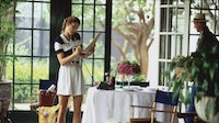 Model Cindy Crawford in Vogue's March 1992 issue talking on the phone in a sunroom | Source: Getty Images