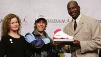 In 2006 Michael Jordan posed with Andrea Kick of Deutsche Kinder-und Jugend Stiftung and German actor Oliver Koritke at Nike Town Berlin in Germany | Source: Getty Images