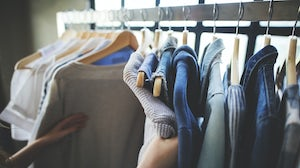 A shopper browsing through clothes | Source: Shutterstock