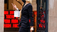A shopper on her phone in Paris, France | Source: Getty Images