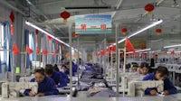 Workers in a factory in Hotan county, Xinjiang, China   Source: Shutterstock