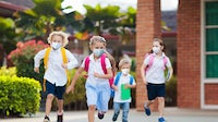 School child wearing face masks and going back to school after Covid-19. | Source: Shutterstock