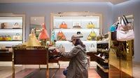 A shopper browses handbags and wallets inside a Furla SpA store in Hong Kong | Source: Getty Images