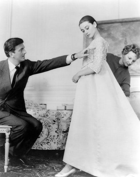 Audrey Hepburn with Hubert de Givenchy in his workshop, in Paris | Photo: Sunset Boulevard/Corbis via Getty Images