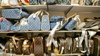 Counterfeit Louis Vuitton bags in a counterfeit goods' store that was raided by Hong Kong customs on December 2, 2005   Source: Getty Images