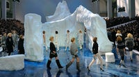 Models walk around a giant iceberg installation on the runway at the Chanel Autumn/Winter 2010 show | Source: Getty Images
