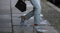 A fashion week attendee wears an Hermès Birkin bag and some Bottega Veneta pumps | Source: Getty Images