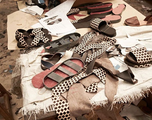 Making men's sandals with recycled tyres in a Kenya workshop | Photo: Aurora James