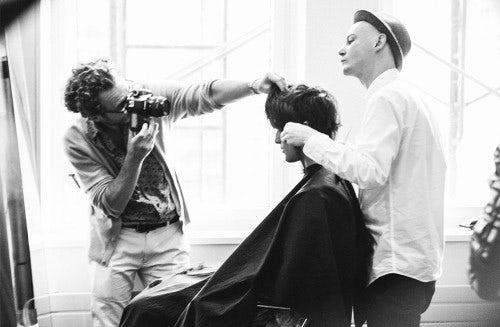 Michael Gordon taking a photo of a hair model | Source: Courtesy